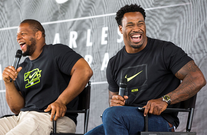 Steven and Ndamukong Suh entertained a crowd of around 200 in Omaha, sharing stories of their youth baseball playing day (Omaha World-Herald Photo).