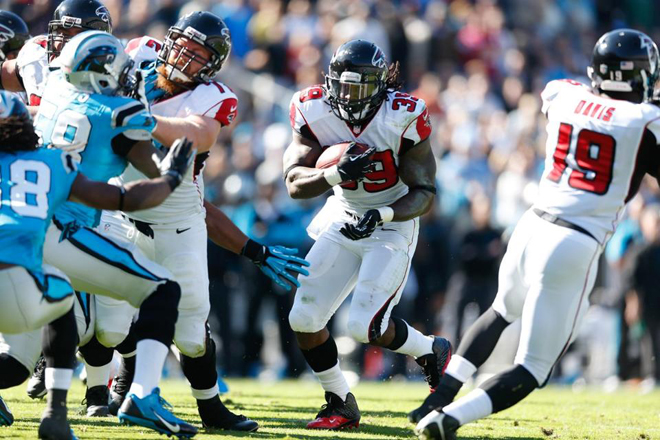 Coach Mike Smith was encouraged by the holes opened up in the run game on Sunday (Atlanta Falcons Photo).