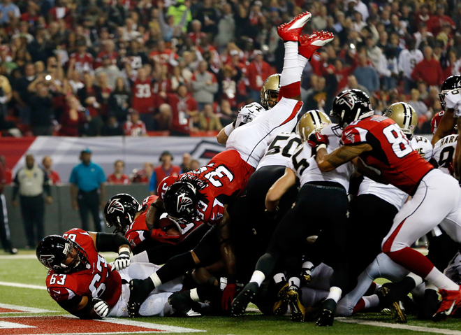 Steven completes his descent into the end zone for a touchdown after leaping over a pile at the goal line (Getty Images).