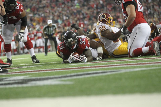 Turnovers were happening all over the place, so I had to make sure I kept the ball secure (Falcons.com photo).