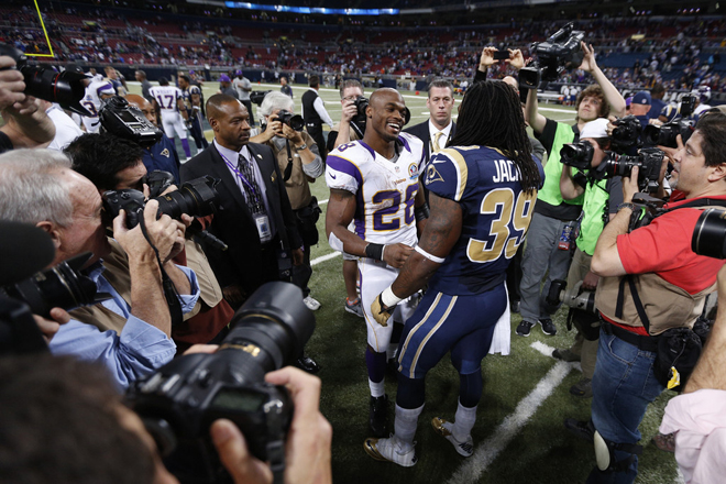 Steven meets Vikings running back Adrian Peterson on the field after the game (Getty Images).