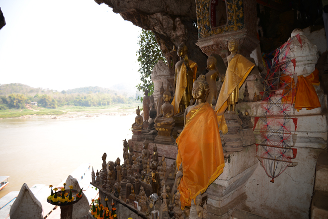 Buddha statues by the Mekong River.