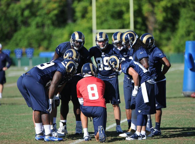 Signal Caller Sam Bradford instructs the huddle at Rams Camp (St. Louis Rams Photo).