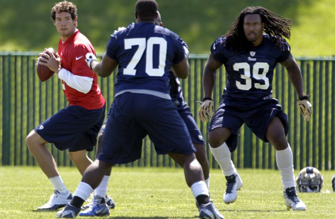 Steven Jackson and Sam Bradford run through drills during Mini Camp at Rams Park on Tuesday (AP Photo).