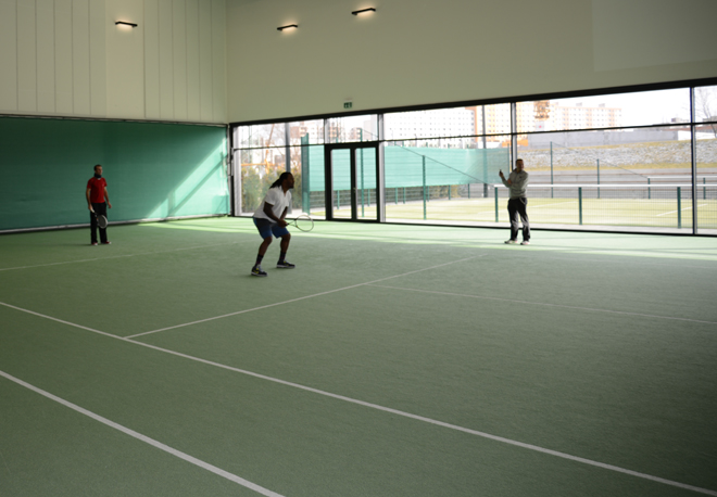 Trying my hand at tennis with Davis Cup Champion Radek Stepnak.
